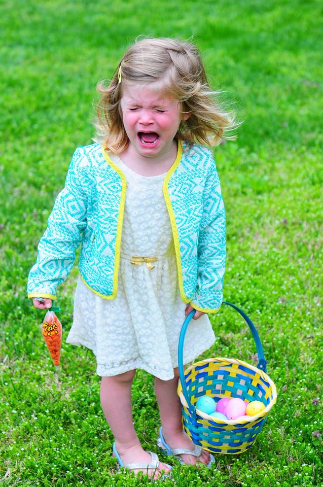 crying little girl with Easter basket
